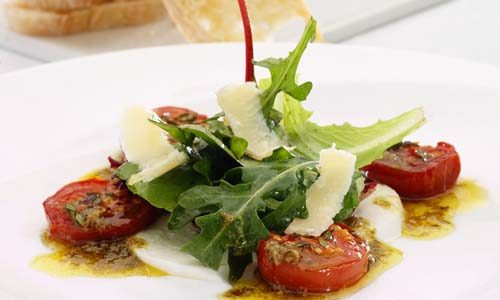 Tomato & mozzarella salad with two dressings Parmesan shavings Keywords: Balsamic lemon infused Olive Oil Close